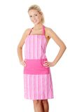 Happy blond nude woman in pink apron Stock Photography