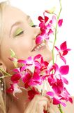 Happy blond with orchid royalty free stock image
