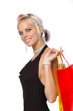Happy blond shopper with bags Stock Photos