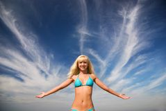 Happy blond smiling girl and the blue bright sea Royalty Free Stock Photos