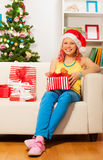 Happy blond smiling girl with presents Royalty Free Stock Photography