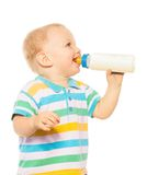 Happy blond toddler with formula Stock Image