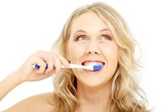 Happy blond with toothbrush Stock Photography