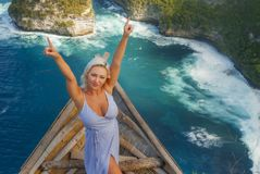 Happy blond tourist woman feeling free on the stunning view of beautiful sea cliff beach at viewpoint enjoying exotic Summer. Young attractive and happy blond stock photos