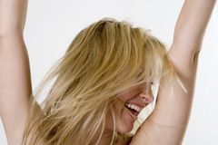 Happy blond woman. A happy blond woman jumping for joy royalty free stock photos