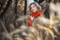 Happy blond fashion woman in autumn forest Stock Photo