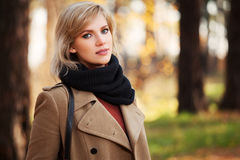 Happy blond fashion woman walking in autumn forest Royalty Free Stock Photo