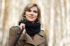 Happy blond fashion woman in autumn forest Royalty Free Stock Photography