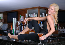 Happy blond woman on bar Royalty Free Stock Photography