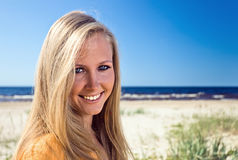 Happy blond woman on a beach Stock Images