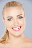 Happy blond woman with a beaming toothy smile Royalty Free Stock Photography