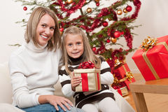 Happy blond woman with child on Christmas Royalty Free Stock Images