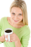 Happy blond woman with coffee on white background Royalty Free Stock Images