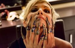 Woman with colorful long nails stock image