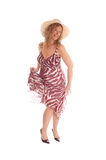 Happy blond woman dancing. A image of a happy blond woman dancing in a summer dress, with an Royalty Free Stock Photography