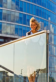 Happy blond woman in downtown Royalty Free Stock Photography