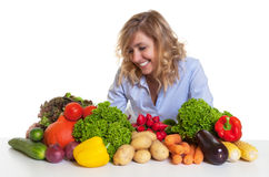 Happy blond woman with fresh vegetables Stock Images