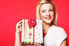 Happy blond woman with a gift Royalty Free Stock Photo