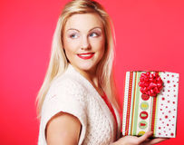 Happy blond woman with a gift Stock Photography