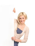 Happy blond woman holding a blank billboard Stock Image