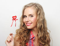 Happy blond woman with little red heart Royalty Free Stock Image