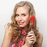 Happy blond woman with little red heart Stock Images