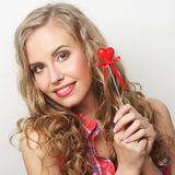 Happy blond woman with little red heart Royalty Free Stock Photography