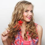 Happy blond woman with little red heart Royalty Free Stock Photo