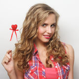 Happy blond woman with little red heart Stock Photography