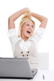 Happy blond woman in office Stock Images