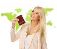 Happy blond woman with passport Stock Photography