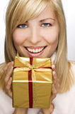 Happy blond woman with present Stock Photos