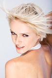 Happy blond woman with a quirky hairstyle Royalty Free Stock Photography