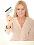 Happy blond woman showing blank credit card Stock Photo