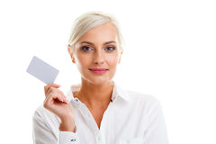 Happy blond woman showing blank credit card Royalty Free Stock Photo