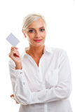 Happy blond woman showing blank credit card Royalty Free Stock Image