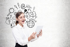 Happy blond woman with a tablet, internet search Stock Photos