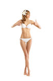 A happy blond woman in a white swimsuit on white Stock Images