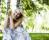 Happy blond young woman in park smiling. Close up Stock Photos