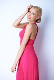 Happy Blond Young Woman in Pink Dress Royalty Free Stock Photo