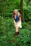 Happy Blonde. A pretty blonde girl, happy out in the forest stock photo