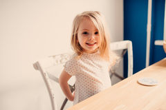 Happy blonde baby girl at home Royalty Free Stock Image