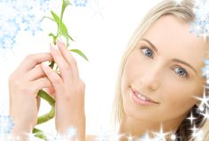 Happy blonde with bamboo Royalty Free Stock Photo
