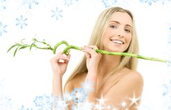 Happy blonde with bamboo Royalty Free Stock Image