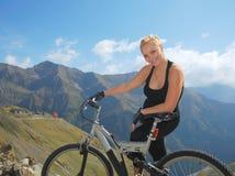 Happy blonde biker Stock Image