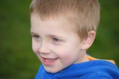 Happy blonde boy. Happy little caucasian boy in the park stock photos
