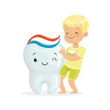 Happy blonde boy standing next to a big smiling tooth, cute cartoon characters vector Illustration Stock Photo