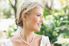 Happy blonde bride wearing pearls Royalty Free Stock Photos