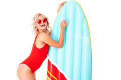 Free Happy Blonde Caucasian Female Lies In Swimsuit With Big Rubber Mattress And Smiles Isolated On White Background Royalty Free Stock Photo - 163849735