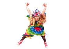 Happy blonde child girl in hippie colorful dress against white wall.  royalty free stock photos